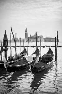 Queued gondolas with Basilica di San Giorgio Maggiore in the background.  Venice, Italy.