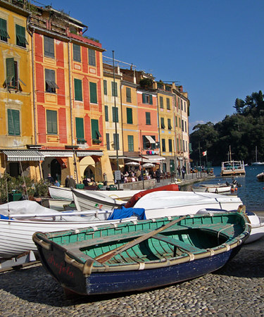 An old wooden fishing boat sits on its side in colorful Portofino - Portofino - Italy