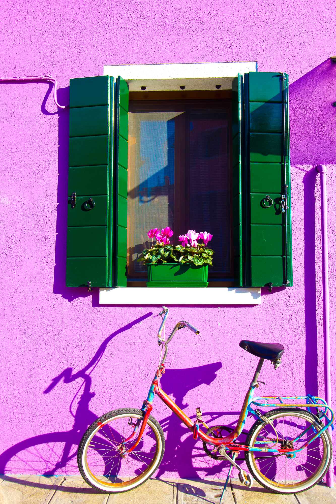 Burano Italy is a great day trip from Venice and features brightly coloured buildings perfect for photographers. No two buildings are the same colour on Burano.
