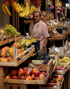 A market vendor looks for customers on a slow afternoon in Sorrento, Italy.