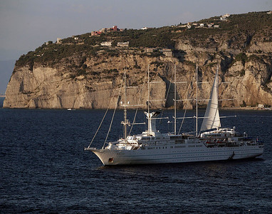 A massive sailing cruise ship departs Sorrento, Italy.