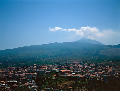 Mount Etna erupts on a sunny spring day. Randazzo, Sicily, Italy.
