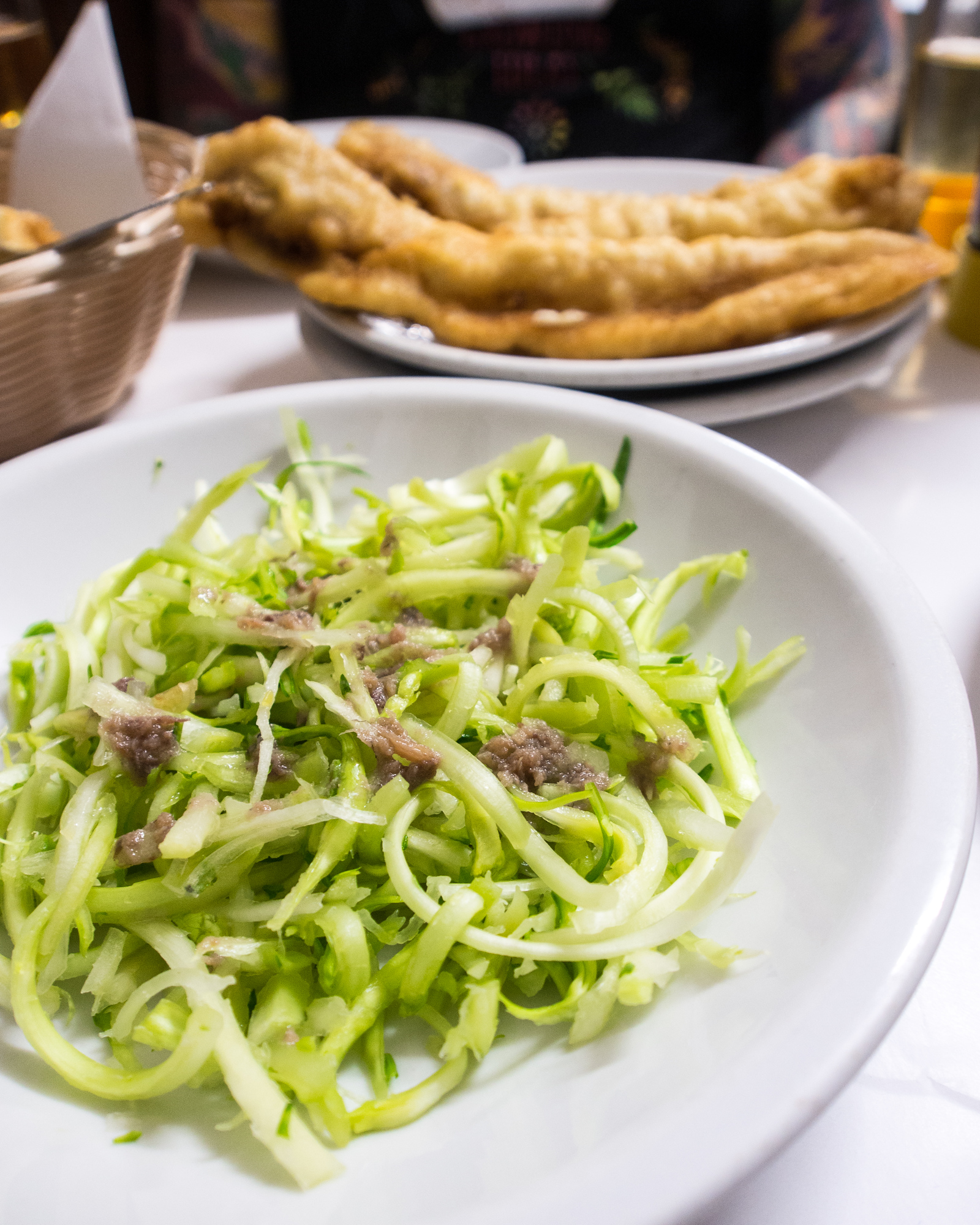 Puntarelle salad at Dar Filetto in Rome. This chicory salad is easy to make with less then 5 ingredients.