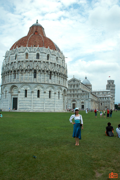 This is the Campo dei Miracoli in Piza. In the background you can see the famous leaning tower. The foreground is the Baptistry and behind it is Duomo and tower. The lawn was a beautiful open grass area that contrasted with the white of the buildings.<br /> IMG_2966
