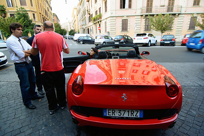 Street scene - don't know what the story was or who was the owner of that Ferrari, but I had to wave at the young lady and admire her ride.