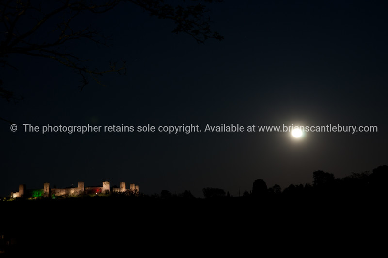 Castel Monteriggioni in the distance at night.  Monteriggioni.  Italian images.