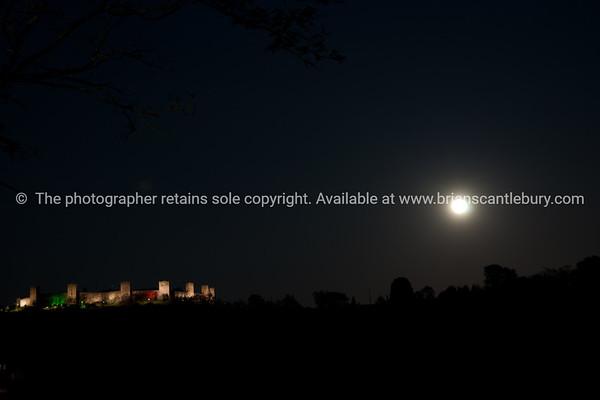Castel Monteriggioni in the distance at night.  Monteriggioni.  Italian images.