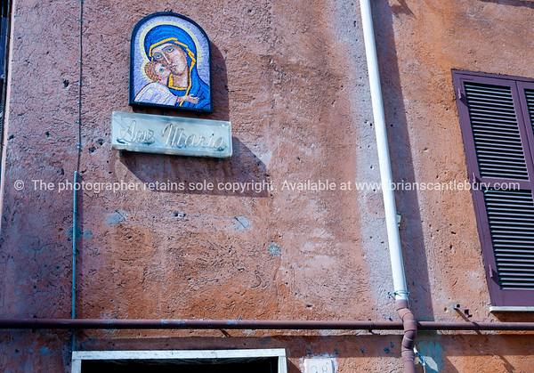 Saint maria image and sign on wall in Rome. Italian images.