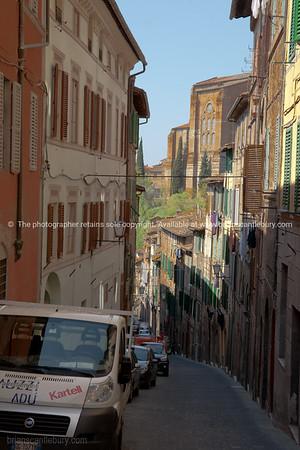 Siena street, walled city. Italian images.