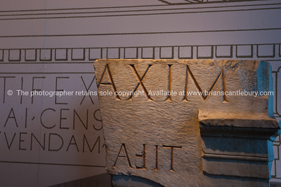 Roman Inscription in stone; Italian images.