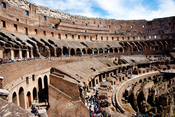 Tourists pour through the Colosseum. Italian images.