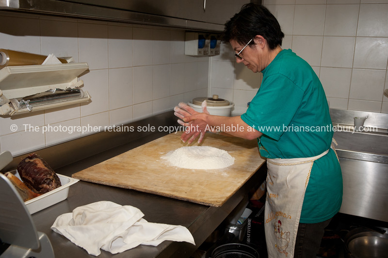 """Umbria, Italy, mixing the bread dough at Umbria, Italy, pasta making at Barcomonte Agriturismo, Gubbio.<br /> Model released; no, for editorial & personal use. SEE ALSO:    <a href=""""http://www.blurb.com/b/2322683-spqr-italy"""">http://www.blurb.com/b/2322683-spqr-italy</a> and  <a href=""""http://www.blurb.com/b/2314371-gubbio-medieval-italy"""">http://www.blurb.com/b/2314371-gubbio-medieval-italy</a>"""