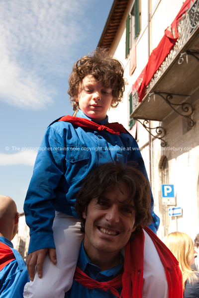 Dressed in colours of their patron saints, the people of Gubbio fill the streets marching and celebrating. Italian images.