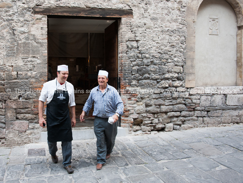 Gubbio, medieval town. preparing food for Festa.
