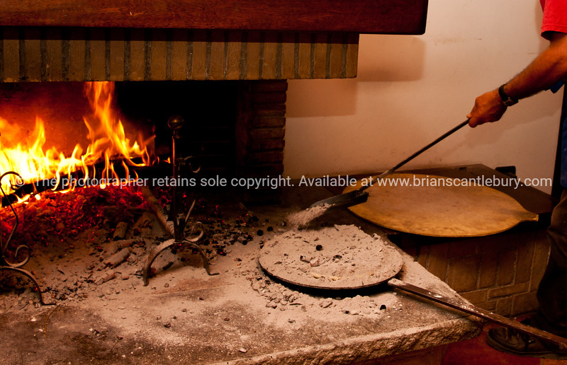 "Fire baking bread at Barcomonte, Gubbio,<br /> <br /> Umbria, Italy, countryside, towns & ruins. SEE ALSO:    <a href=""http://www.blurb.com/b/2322683-spqr-italy"">http://www.blurb.com/b/2322683-spqr-italy</a> and  <a href=""http://www.blurb.com/b/2314371-gubbio-medieval-italy"">http://www.blurb.com/b/2314371-gubbio-medieval-italy</a>"