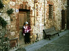Kira in a doorway at Monteriggione