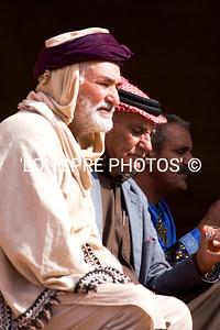 Group of Jordanian men listening to music.