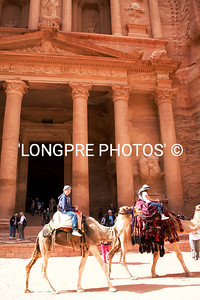 Camel riders passing front of TREASURY.