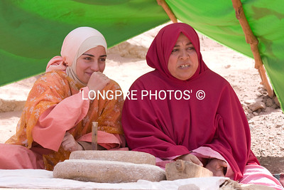 Two Jordanian women checking out the tourists.