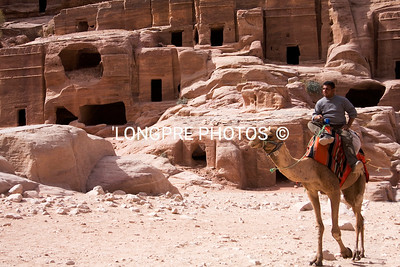 Camel with rider at lower Petra carved homes.