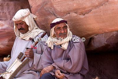 Two men enjoying some music.  Art work.