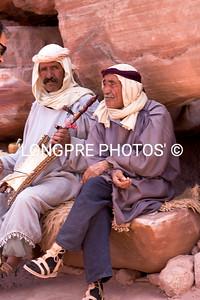 Two men enjoying music.