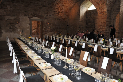 Official dinner at Riddarsalen in Bornholm Castle (The Knights banquet hall).  In the island of Öland, Sweden, in the Baltic sea. The Swedish royal family has its Summer mansion close to this castle ruin of Borgholm.