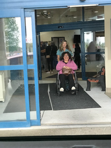 Denise Lantz being brought out of Timmins and District Hospital in wheelchair after gastroscope