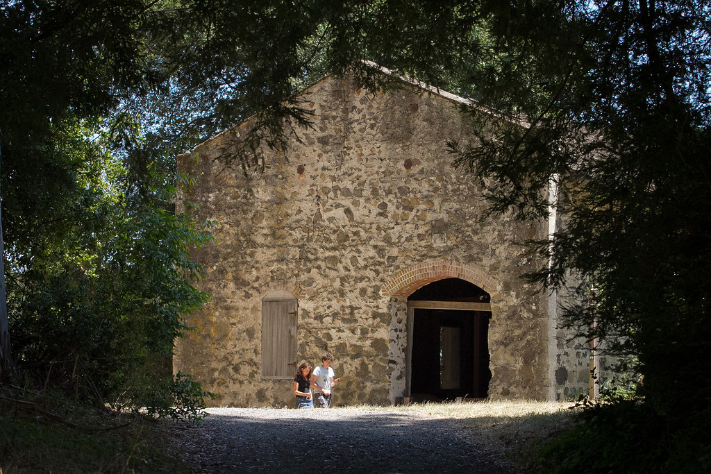 A couple walks past the Distillery at Jack London State Park in Glen Ellen, Calif., on Friday, July 13th, 2012.