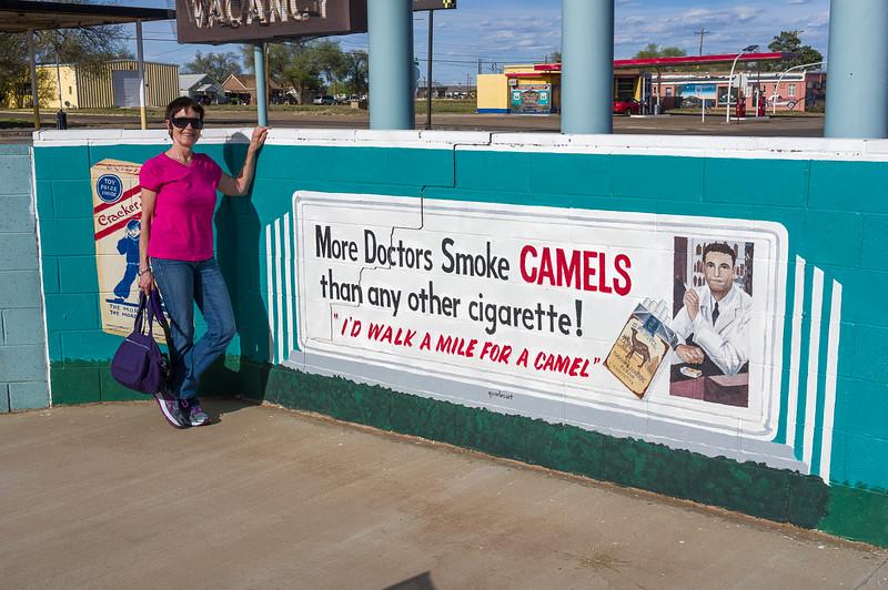 Jacki Beside the Camel Sign