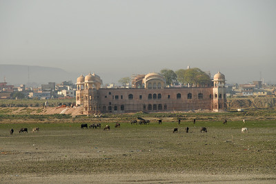 "Jal Mahal (""Water Palace"") seen from Kanak Vrindavan Garden  Jal Mahal is an 18th century pleasure palace and is located in Jaipur (Capital of Rajasthan State). The palace is amidst Mansagar lake, which is nestled amongst the Nahargarh hills. The Jal Mahal Palace, Jaipur is noted for its sophisticated design and grand architecture. The first four floors of this building is under water, only the top floor remains outside."