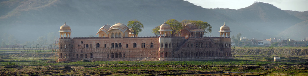 """Panoramic image of Jal Mahal (""""Water Palace"""")  Jal Mahal is an 18th century pleasure palace and is located in Jaipur (Capital of Rajasthan State). The palace is amidst Mansagar lake, which is nestled amongst the Nahargarh hills. The Jal Mahal Palace, Jaipur is noted for its sophisticated design and grand architecture. The first four floors of this building is under water, only the top floor remains outside."""