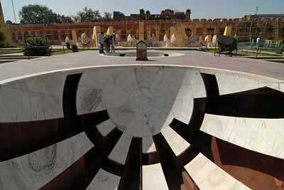 Jantar Mantar, Jaipur, Rajasthan, India   In Sanskrit, 'Jantar Mantar' is used for 'Magical Devices' and it is undoubtedly so with the huge masonry instruments, which were placed here to measure 'the harmony of the heavens'. Conceived and constructed by Sawai Raja Jai Singh II, it was completed in seven years (1728 to 1734). Each instrument that forms a part of this observatory is assigned and used for a particular function and is known to give an accurate reading. The Samrat Yantra is a large sundial that looks like a triangular structure and is marked with hours and minutes. The arc at the left shows the time from sunrise to midday while the arc at the right side shows the time from midday to sunset. The time is read by observing where the shadow is sharpest at the time. The sundials have been constructed on latitude 27o north and to adjust the reading to the Indian standard Time (IST), one has to add anything between 1 minute 15 seconds to 32 minutes according to the time of year and solar position. The Dhruva Yantra is used to locate the position of 12 Zodiac signs and also the Pole Star at night. The traditional unit of measurement started with the smallest unit being 'human breath' that has been calculated to be of 6 seconds duration. According to this scale, 4 breaths or 24 seconds equals 1 pal, 60 pals or 24 minutes equals 1 ghadi and 60 ghadis or 24 hours equals 1 day. The Narivalya Yantra is a distinctive sundial with two dials - the first dial facing south reads time when the sun is in the southern hemisphere, i.e., from 21 September to 21 March each year and the other one facing north reads time for the rest of the year when the Sun is in the northern hemisphere, i.e., from 21 March to 21 September. The various other instruments include Jai Singh's seat (the seat of the Observer), Kranti Yantra used for direct measurement of the longitude and latitude of the extraterrestrial bodies, Raj Yantra or the King of Instruments used only once a year to calculate