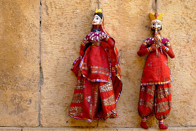 Puppets in Rajasthan, India. Seen in the image is a man playing a musical instrument to woe the lady puppet doll. :)