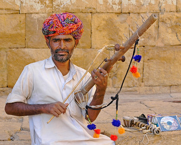 Street musician at the Jaisalmer Fort, Rajasthan, India. South Asia. He is now famous enough that he has cut a low cost audio CD for himself and sells it.