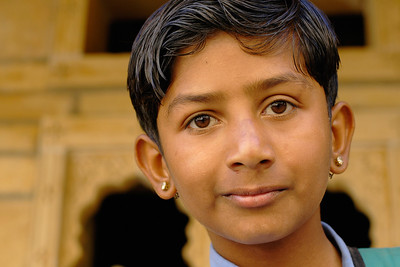 This school kid was so excited to know that we were from Bombay (Mumbai) as he wants to grow up and become a star in Bollywood. Image shot in the Jaisalmer city, Rajasthan, India. South Asia.