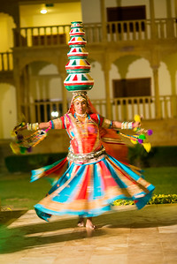 Rajasthani Folk dancer perform with pots on the head in Jaisalmer, Rajasthan, India.