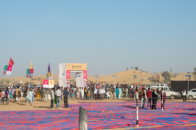 Jaisalmer Desert Festival - camel races, polo matches, puppeteers, jugglers, men with long mustache, turban tying competitions, locals dressed in colorful traditional dresses. Sam desert near Jaisalmer, Rajasthan, India.
