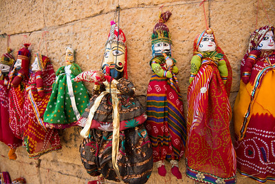 Kathputli (Puppet) Jaisalmer, Rajasthan, India. Rajasthani string puppetry is vibrant and thriving. These handmade wooden puppets are much more than just plaything or decorative dolls. They are a part of the traditional performance of puppetry – narrating an event from history, myths, folklore or legend, complete with music and speech. They are the repository of traditional wisdom, knowledge and social mores. Within them are contained the oral history of the region.  The tradition of handmade string puppets of Rajasthan is more than a thousand years old. It is known as 'Kaathputli' ('kaath' means wood, and 'putli' is puppet, i.e. wooden puppet) and mainly practiced by the Bhat community.