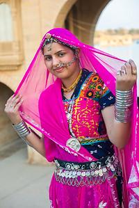 Traditionally dressed Rajasthani lady near Gadi Sagar Lake in Jaisalmer, Rajasthan, India.