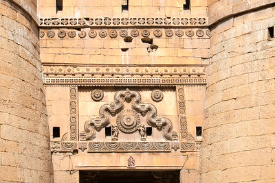 Jaisalmer Fort is one of the largest fortifications in the world and is a World Heritage Site. It was built in 1156 AD by the Rajput ruler Rawal Jaisal, from whom it derives its name. The fort stands amidst the sandy expanse of the great Thar Desert, on Trikuta Hill, and has been the scene of many battles. Its massive yellow sandstone walls are a tawny lion colour during the day, fading to honey-gold as the sun sets, thereby camouflaging the fort in the yellow desert. For this reason, it is also known as the Sonar Quila or Golden Fort. Jaisalmer, Rajasthan, India.