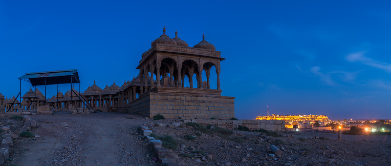 Panoramic view of Jaisalmer Fort, Rajasthan, India from sunset point at Vyas Chatri, Jaisalmer, Rajasthan, India. There are two groups of Cenotaphs (Vyas Chhattri for Brahmins and Bada Bagh for the royal families) situated at the end of town giving a spectacular view of the Jaisalmer Fort and the Sunset opposite it. Jaisalmer, Rajasthan, India.