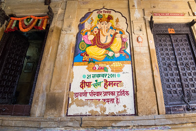 Entrance to homes are brightly decorated and often with pictures of Gods and Godesses like Ganesha. Jaisalmer, Rajasthan, India.