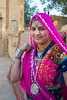 Traditionally dressed Rajasthani lady near Gadi Sagar Lake in Jaisalmer, Rajasthan, India.