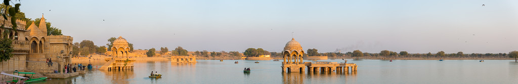 Panoramic view of Gadisar Lake, Jaisalmer, Rajasthan, India. Gadisar lake built by Maharaja Gadsi Singh is surrounded by temples and tombs of saints. Tourist often do boating here.