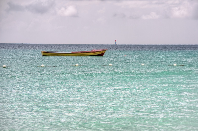 Another boat waiting out at sea off the beach in Negril.