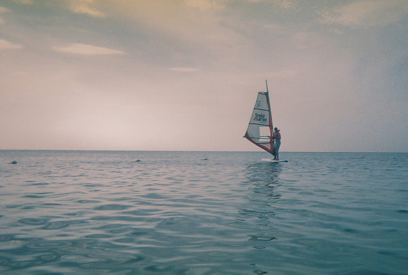 A picture with our disposable camera of me out on the water windsurfing.