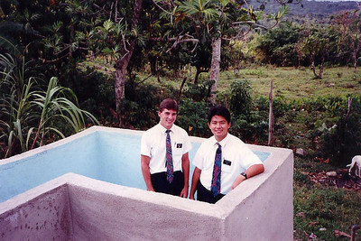 Elder Beck & Salleh stand in the baptism font they built since there was no chapel in Highgate.  Prior to this, all baptism were performed at the beach.  Elder Beck had done most of the work on the font - he built pools in Florida prior to his mission.