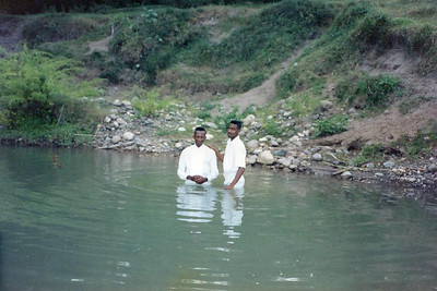 Elder Hansen & Salleh taught Sean (on the left) and he got baptized in this river in May Pen by a member of the May Pen branch.