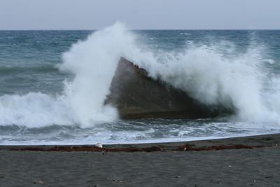 Waves crashing ashore on remnants of a shipwreck. Kingston, Jamaica